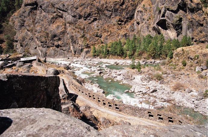 A view of the river junction from the east in 2006. This shows the outer walls of Jung Bahadur's fort. The new fly-over bridge will cross between the two very large boulders seen as integral parts of the walls of the fort.