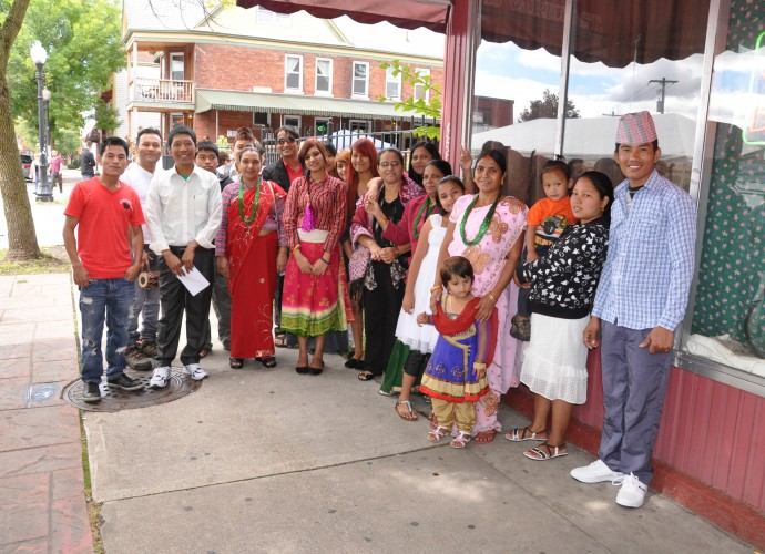 A multi-family group of Bhutanese-Nepali refugees participated in the Asian Folk Hour at the Utica Music and Arts Festival on Varick St. in Utica, NY in Sept. 2012. Photographer: Lynne Browne.
