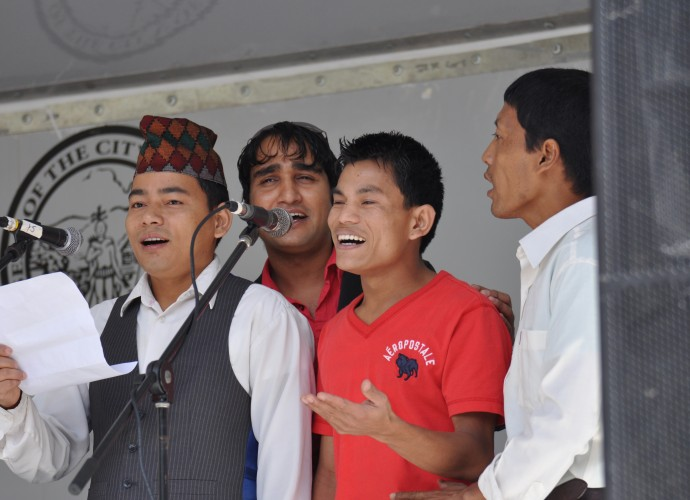 Members of the Bhutanese-Nepali Folk Collective perform at the Utica Music and Arts Festival. They share their Nepali folks songs and dances with an American audience. General Manager Tek Monger and his friends have always loved music and when they lived in Nepali refugee camps, they used to sing away their sorrows with traditional Nepali folk songs. Sept. 15, 2012. Photographer: Lynne Browne.