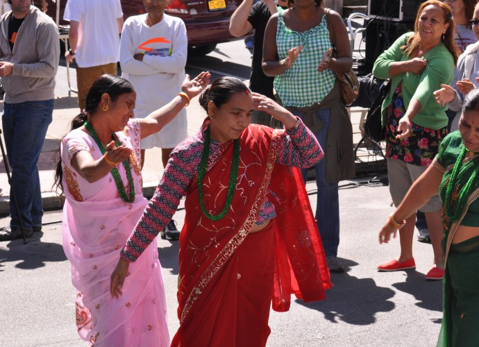 There are few things that make Dorna Baniya and Guyatri Rijal happier than dancing. It is rare that they get a chance to share their culture with an audience outside of the local refugee center. This photo was taken at the Utica Music and Arts festival, Sept. 15, 2012. Photographer: Lynne Browne.
