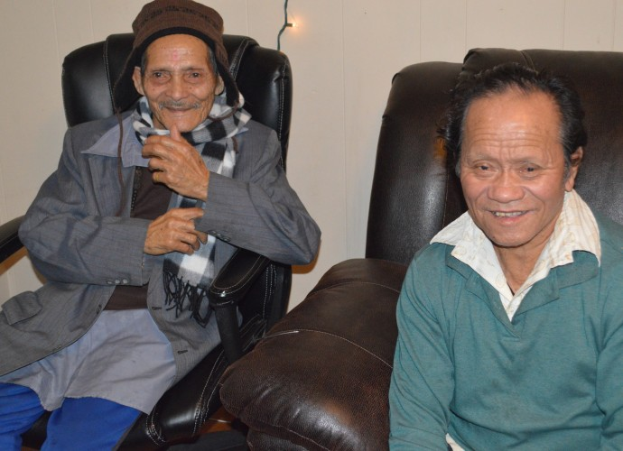 Grandpas Biswas and Monger relaxing and talking. It is often difficult for older people who do not speak much English to adjust to the changing lifestyles and community. They like to tell stories about when they were young men in Chirang, Southern Bhutan. Oct. 2013. Photographer: Krishna Adhikari.