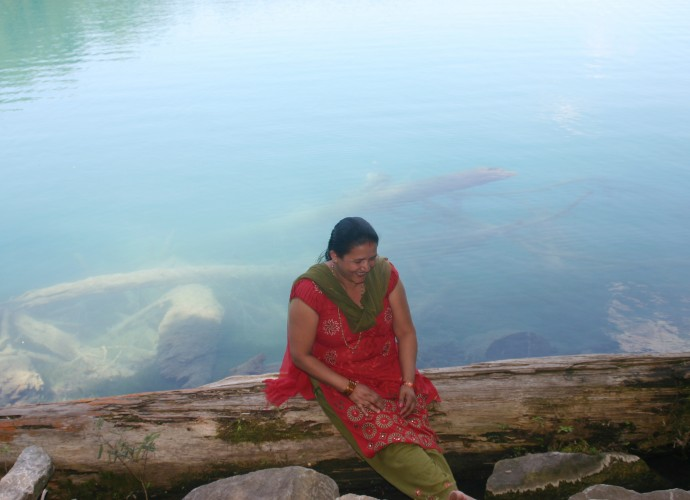 Green Lakes State Park near Syracuse, NY is a popular picnic destination and was the site of this photo taken of Nara Adhikari. The residents of Utica have many connections with the larger Bhutanese-Nepali community in Syracuse and some people go there often for visiting and shopping at the Nepali stores. July, 2012. Photographer: Terrin Munawet.