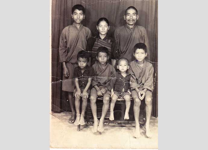 The Bhutanese government conducted a census in 1988 and required that every family submit a group photograph. This photo of the Ranamagar family was taken just a few weeks before they were forced to leave Bhutan as refugees in 1992. From there, the family moved to Goldhap and then Beldangi 3 refugee camps in Jhapa, Nepal, where they lived for almost 20 years before being resettled to Utica, NY. Amber Ranamagar (from the previous two photos) is again featured here standing up on the far left. Photographer: Unavailable. Permission to publish from Harka Ranamagar.