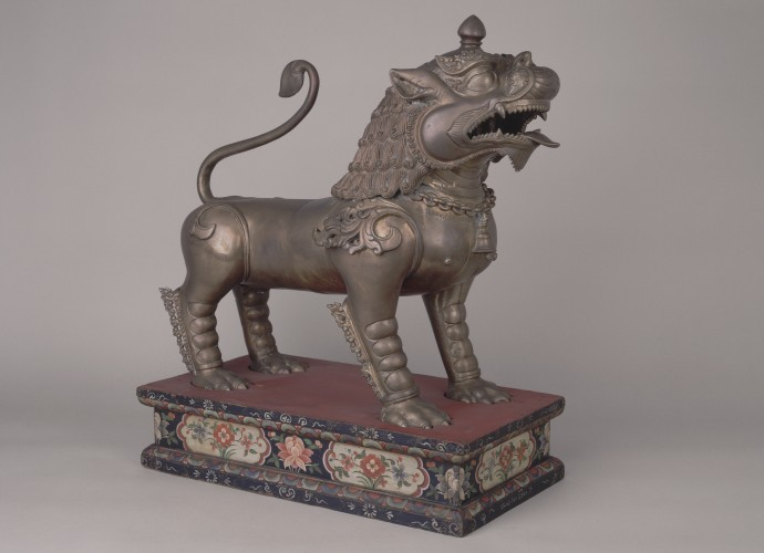 <p>One of a pair of <em> senge</em> (guardian lions) <br /> Made in Patan, Kathmandu Valley, Nepal <br /> 1908, inscribed with the Vikrama year 1965 (1908) <br /> Commissioned or bought by, Rai Sahib Laksminarayan Pradhan <br /> Gifted to, Sir Charles Bell, Political Officer for Sikkim, Bhutan and Tibet (1908-18) <br /> Courtesy of National Museums Liverpool, 50.31.20a+b <br /> </p>  <p>Rai Sahib Laksminarayan Pradhan, the son of the first Newar settler in Sikkim and subsequently powerful landlord either commissioned or bought the <em>senge</em> shortly after they were made. He gifted them to Charles Bell soon after. The year 1908 is significant as this was the year Charles Bell was appointed to the post of Political Officer in Sikkim and the year Pradhan received his imperial title, 'Rai Sahib.' </p>