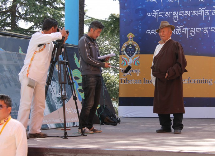<p>Pema Tashi (cameraman), Sonam Wangdue (interviewer) and Kundeling Thupten (performer)<br />
