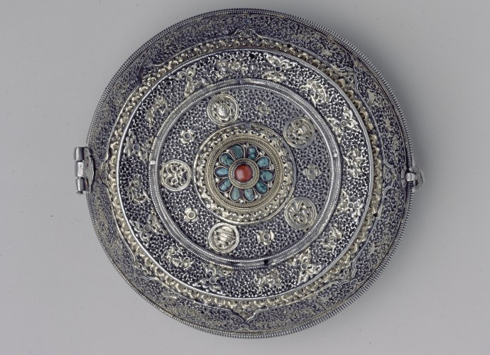 <p>Lime Box or <em>trimi</em> <br /> Bhutan <br /> Late 19th or early 20th century <br /> John Claude White collection <br /> Courtesy of National Museums Liverpool, 56.27.232</p>  <p>John Claude White presented his Tibetan and Himalayan objects based on their aesthetic values. His collection not only contained religious objects, but objects owned and coveted by the aristocratic elites of the Himalaya. He especially respected the skills of the region's metal workers and silversmiths and his collection is notable for its weapons and armour (some taken during the bloody campaign of Younghusband in 1904). He was also gifted high status pieces by the ruler's of Sikkim and Bhutan, including a number of lime boxes or <em>trimi</em>. John Claude White made diplomatic visits to Bhutan in 1905 and 1907 and these lime boxes are likely to have been presented to him as diplomatic gifts during one of these Anglo-Bhutanese encounters. </p>