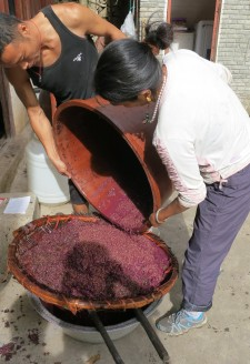 <b>Sieving the fermented wine.</b>
