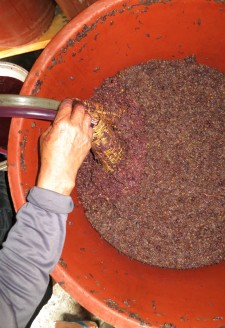 <b><p>Bamboo is wrapped around the end of the tubes as a filter while pumping fermented wine. </b></p> The filtration and sieving process is repeated several times until the wine becomes a pure liquid free of sediment.