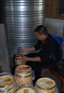 <p><b>A company hired Wu Gongdi's family to make wine for its employees as an annual bonus gift. The mini-barrels the company used to hold the wine are labeled 'Cizhong Chateau.'</b></p>  In 2014, Wu Gongdi's family also began experimenting with storing and fermenting wine in oak barrels for the first time, as part of an agreement with a corporation in the provincial capital that hired his family to make wine as gifts for their employees. The ratio of production of the wine is 1 kilo of raw grapes for every half liter of finished product.