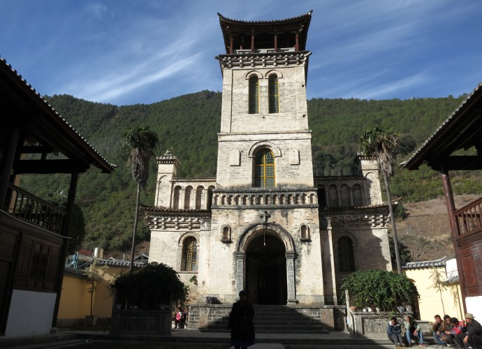 <b><p>Cizhong Church built with Western and Chinese architectural styles.</b></p> The village of Cizhong is situated along the upper Mekong River in Diqing Tibetan Prefecture of Northwest Yunnan Province. A unique feature of Cizhong is that the community consists of many Tibetan Catholics, a religion that French and then Swiss missionaries introduced in the late 19th and early 20th centuries (Deshayes 2008; Lim 2009). This is highly unusual in and of itself since Tibetans are known worldwide as devout Buddhists. Additionally, the Catholic missionaries introduced grape cultivation and winemaking to this village; both practices that have been revived and carried on by villagers today in response to increasing tourism interest in Cizhong and its Catholic history.
