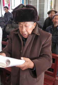 <b><p>An 86-year old devout catholic elder and local historian who used to assist the French and Swiss fathers before the 1950s.</b></p> Most households are engaged in the practice of winemaking, and keep vineyards and small cellar spaces in their homes. Cizhong wine is purely handmade using simple techniques. It is a rural household industry using some techniques whose earliest historical references can be traced back to the Catholic missionaries over a hundred years ago. The original use of wine in Cizhong was purely ritual-based; for mass in the village church. As one village elder who studied with the French and Swiss missionaries prior to the 1950's and is now renowned as a local historian has stated:  <p><p><em> Wine is important to local culture because it is needed for Catholic mass, and this ritual can't take place without wine. Wherever there is a church there is a vineyard; wine is not for play, it is for ritual. The French brought grapes overland from Vietnam, Nepal, and Tibet. These fathers traveled and brought grapes and wine to Sichuan and Tibet earlier before their arrival in Cizhong.</em></p></p>