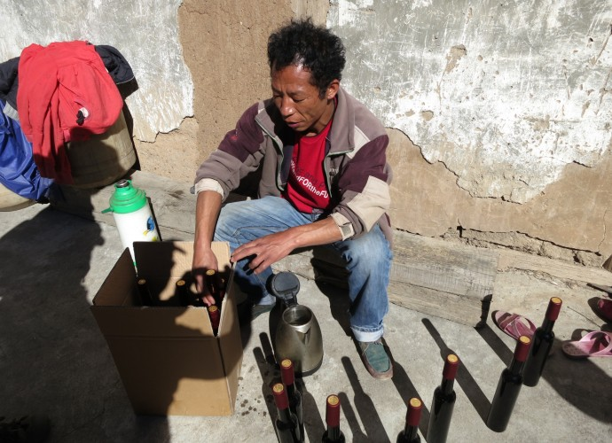 <b><p>Bottling 'Cizhong' labeled grape wine.</b></p> Similarly, Wu Gongdi, whose household winemaking is discussed below and who is recognized as the first villager to renew a winemaking tradition in 1998, has also discussed wine, Catholicism, and local culture as being heavily linked together:  <p><p><em> I think Catholic culture is part of Tibetan culture, so wine is also part of Tibetan culture. But you also can't talk about wine without talking about Catholic mass.  The fathers who were here even learned to speak Tibetan and I think this also makes wine part of Tibetan identity here…We were the first family to regularly make wine, so for my family yes, it is very important to our identity. </em></p></p>