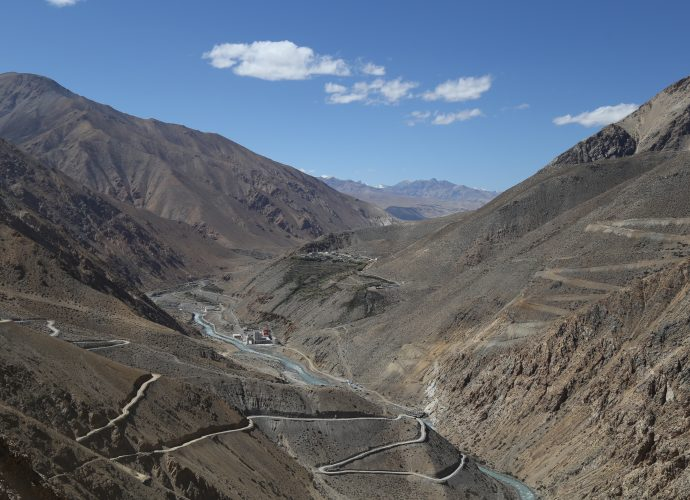 From Nara La pass, looking north towards Sher village in Tibet (China), September 2017.  The road winding down from the left is the road from the Nara La to Hilsa. Along the river is the road to Tibet, and winding up from the bridge on the right is the road to Limi Valley located in the northernmost corner of Humla. The village on the other side of the river is Sher, the nearest Tibetan village on the Nepali border, and below the village is the newly built Chinese customs and immigration building. The Karnali river flows down from Tibet to Nepal through Hilsa.