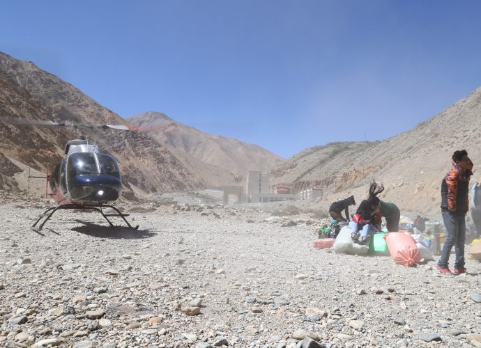 "Helicopter taking off from Hilsa, September 2017.  Roughly 13,000 Indian pilgrims visited Mt. Kailash through the Simikot – Hilsa route in 2017, nearly all of whom were air-lifted by helicopters from Simikot to Hilsa.* Locals along the Simikot – Hilsa route complain of not benefiting from this mass influx of pilgrims who come and go by air, while the newly elected local governments discuss ways to distribute the benefit of this economy within Humla. ""One of the ways,"" local youth Pema Tharchin says, ""is to finish the construction of the road so pilgrims can drive instead of flying."" Meanwhile, new guest houses are under construction in Simikot and Hilsa amidst uncertainties of the pilgrim and trekking economy, which has skyrocketed after the shutdown of another border leading to Tibet in Kodari following the 2015 earthquakes in Nepal.  * 'Kailash Manasarovar Yatra likely to see record numbers,' The Kathmandu Post, 16 May 2018."