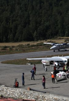 "Simikot airport, October 2017.  While waiting for flights at Simikot airport in October, someone in the crowd sarcastically shouted, ""Ayo, ayoo…Giddha Air ayoo"" (Eagle Air is coming), which happens to be a popular pun to crack the dullness of endless waiting. Flying on twin-otters and single engines is the easiest way to get to Simikot from Nepalgunj; the other option being 3-5 days walk from the neighboring district. Airlines tend to abandon places like Humla when they need it most, namely, from October to December when Humlis fly down to Kathmandu, and from March to May when they return. This is because the timing coincides with the tourist season in the Everest region when most airlines turn towards ferrying tourists back and forth to Lukla where the trek to the world's highest mountain begins. Foreigners pay more than twice the local fare, so between June and August when thousands of Indian pilgrims going to Kailash travel through Simikot, airplanes and helicopters compete for space in Simikot airport. There have been several local protests in the Karnali, including the hold up of a few twin-otters for several days in Simikot. Nothing significant has changed when it comes to air transportation for locals in Karnali."