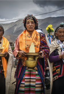 Wedding Ritual. (Yungdrung Tsewang, May 2016)  Wedding reception in the Jharkot village of Mustang, Nepal. Women carrying torma (T. religious sculpture of dough prepared out of flour) in the center, and chang and arak (locally-made alcohol), sing and welcome a newlywed couple to give them blessings for a prosperous future.