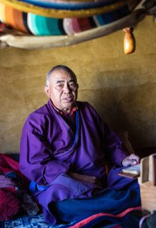 Scriptures. (Kory Thibeault, October 2016)  His holiness, Yungdrung Gyaltsen Rinpoche, is a reincarnated lama now living in in the Lubra village to serve as a religious practitioner to preserve the older Bön traditions in this region. His vast knowledge is highly respected by people throughout the Mustang district.