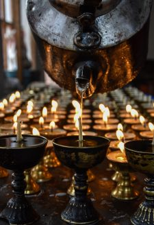 Hope and Blessings. (Yungdrung Tsewang, September 2017)  Butter lamp offerings in memory of a spiritual leader—the 33rd abbot of the Menri lineage of a pre-Buddhist religion known as Bön. Although the religious tradition of Bön is not as prevalently practiced today, the small village of Ludak is one exception. This Bonpo settlement has maintained the ancient traditions of Bön and continue to practice in the face of ongoing development and social change