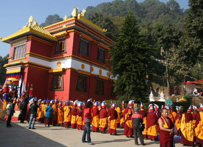 Triten Norbutse monastery in December 2012 during the Light-Swirled Mendrup celebration. A ceremonial procession of monks leads to one of the venues within the monastic compound where the individual parts of the ritual were performed. About one thousand people witnessed and took part in the ritual, and, most importantly, received the consecrated mendrup medicine.