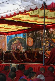 Yongdzin Tendzin Namdak Rinpoche gives the empowerment of the Light-Swirled Mendrup performance to the gathered assembly of monks and lay participants at Triten Norbutse in 2012. Yongdzin Rinpoche supervises the entire mendrup ritual and leads the congregation through the most important parts of the rite. All the necessary empowerments are bestowed by him. Yongdzin Rinpoche also presides over the concluding celebration of distributing the accomplished mendrup medicine. This rare event is attended by about one thousand people, all of whom wish to obtain at least a little of the precious mendrup substance.