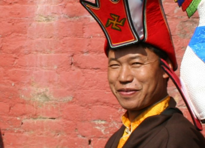 Amchi Nyima, the main Sowa Rigpa practitioner of the monastery, who was assigned the task of compounding the mendrup medicine. He is wearing the typical Bonpo white-blue hat with the auspicious sign of the left-turned swastika (dkar mo khyung gshog). Here, he is taking part in a procession which formed a part of the mendrup ritual.