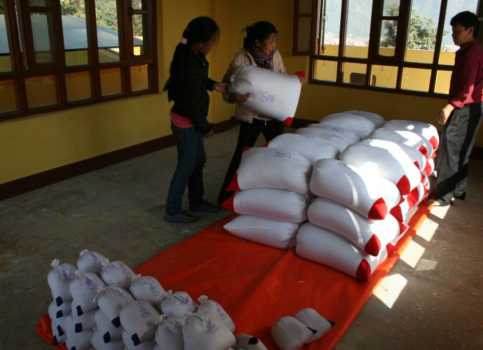 About one thousand kilograms of the mendrup medicine have been produced in preparation for the ritual, and packed in cotton bags used for keeping Sowa Rigpa drugs at the monastery's medical clinic. Amchi Nyima has been organizing and carrying out the work, supported by his students. Different sizes of bags are chosen for different recipients of the medicine: large bags are sent to other Bonpo monasteries and also kept at Triten Norbutse, middle-sized bags are prepared for the sponsors of the ritual. The amount of the mendrup medicine cannot fit into the medicinal vessels placed on the mandala, and thus will remain in bags also for the duration of the ritual.