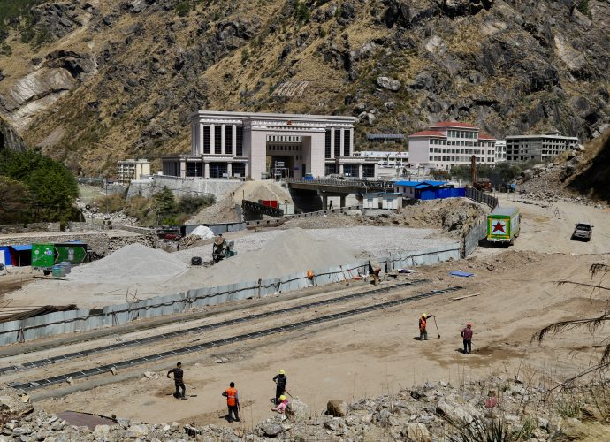 Construction site of the integrated border facilities and check post, Rasuwagadhi. Nepal and China signed an agreement in April 2015 to construct an integrated border facility at the Rasuwagadhi border in Nepal, with the objective of boosting overland trade between the two neighbors, as well as to ease the cross-border mobility of its citizens. According to the agreement, China agreed to provide consultation and financial aid to build a dry port at Rasuwagadhi, near the friendship bridge. The construction of the planned dry port and border facilities began in 2019, nearly four years after the agreement was signed.