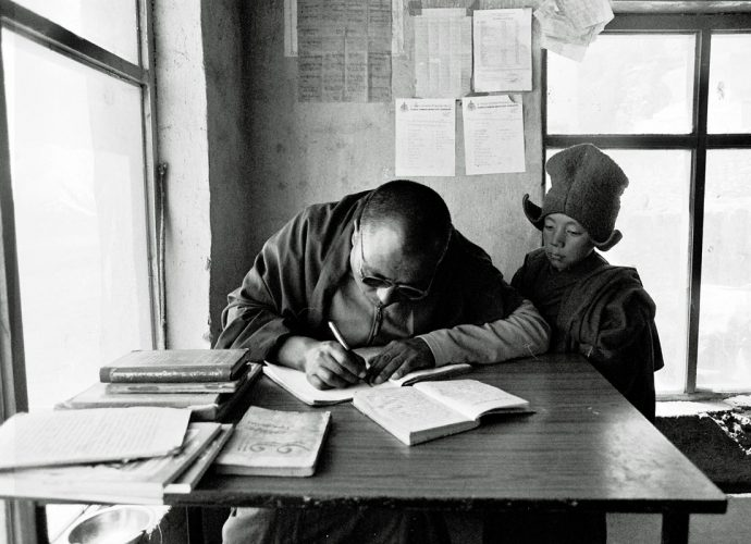 A Tibetan lama from Kham, who is a long-term resident at Karsha monastery, teaches a young Zanskari monk Bod yig (Tibetan script) by writing model sentences in the student's notebook, which the young monk then needs to carefully and diligently copy. In a traditional Tibetan-style monastic school, learning happens predominantly through continuous repetition and memorization. While the perpetually practiced formulae are inscribed into student's long term-memory, the discernment of meaning is treated as a secondary effect of a continuous and progressing learning process. It is not assumed it should be there from the beginning. The motto seems to be: 'Learn it well first and then you can understand it'.